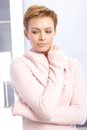 Portrait of mysterious woman young in pink pullover Stock Image