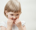 Portrait of a naughty little girl Stock Photography