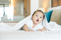 Portrait of a newborn Asian baby on the bed Royalty Free Stock Photo