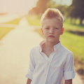 Portrait of a nice child on the road in the sunny Royalty Free Stock Photo