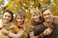 Portrait of a nice happy family relaxing in autumn Stock Images