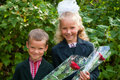 Portrait of nice little schoolgirl and schoolboy Royalty Free Stock Photo
