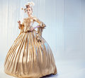 Portrait of a noble woman wearing golden victorian gown Royalty Free Stock Photo