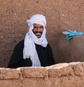 Portrait of a nomad man berber with traditional hat in merzouga morocco Stock Image