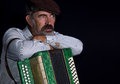 Portrait of an old country man with button accordion Royalty Free Stock Photo