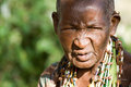 Portrait of an old hadzabe woman lake eyasi tanzania february unidentified looks seriously in the bush on february in tanzania Stock Photo