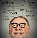 Portrait of old man with glasses looking up closeup contemplating about life isolated on gray wall background copy space Royalty Free Stock Image