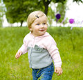 Portrait of the one year old little girl in park funny baby summer Stock Photography