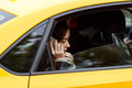Portrait out window car of pensive woman talking on cellphone Royalty Free Stock Photo