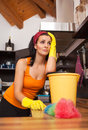 Portrait of overworked woman in kitchen sad and Royalty Free Stock Photo