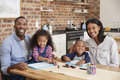 Portrait Of Parents And Children Drawing At Table Royalty Free Stock Photo
