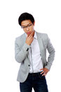 Portrait of a pensive asian man isolated on white background Stock Images