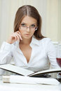 Portrait of pensive business woman in glasses posing with folder Stock Photography