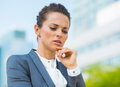 Portrait of pensive business woman in modern office district into the ultra trends Royalty Free Stock Photography