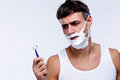 Portrait of a pensive man shaving Royalty Free Stock Photo