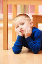 Portrait of pensive or tired boy child kid. Emotions. At home. Royalty Free Stock Photo