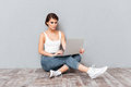 Portrait of a pensive young brunette girl using laptop Royalty Free Stock Photo