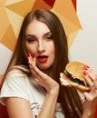 Playful girl posing with burger Royalty Free Stock Photo
