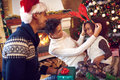 Portrait of playful family and child during Christmas Royalty Free Stock Photo