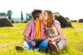 Portrait of playful young love couple having fun in forest outdoors Royalty Free Stock Photography