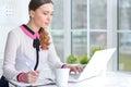 Portrait of a pleasant business woman with a laptop