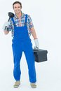 Portrait of plumber holding plunger and tool box full length over white background Stock Photos