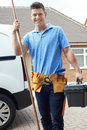 Portrait Of Plumber With Van Outside House Royalty Free Stock Photo