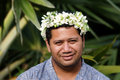 Portrait of polynesian pacific island tahitian mature man aituta male wearing exotic flowers top bouquet smile out side his home Royalty Free Stock Photos
