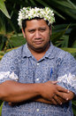 Portrait of polynesian pacific island tahitian mature man aituta male wearing exotic flowers top bouquet smile out side his home Royalty Free Stock Photo