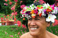 Portrait of polynesian pacific island tahitian mature woman aitu female wearing exotic flowers top bouquet smile in here home Royalty Free Stock Image