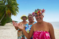 Portrait of polynesian pacific island tahitian mature woman aitu females smiles and wave haloha hellow on the beach in aitutaki Royalty Free Stock Photography