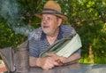 Portrait of positive bearded elderly man bee-keeper Royalty Free Stock Photo