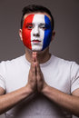 Portrait of Pray France football fan in game  of France national  team look at camera. Royalty Free Stock Photo