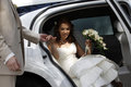 Portrait of a pretty bride shy in car Royalty Free Stock Image