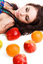Portrait of a pretty brunette with fresh fruits Stock Photo