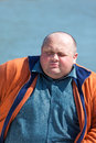 Portrait of a pretty fat man on background water Stock Image