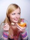 Portrait of pretty girl eating cake