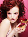 Portrait of pretty girl eating cake, close up