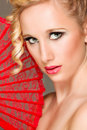 Portrait of pretty girl with textile fan in hand Royalty Free Stock Photo