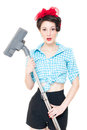 Portrait of a pretty happy smiling young housewife with hoover on white background Royalty Free Stock Photography