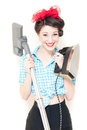 Portrait of a pretty happy smiling young housewife with iron hoover on white background Royalty Free Stock Photo