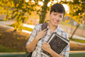 Portrait of a Pretty Mixed Race Female Student Holding Books Royalty Free Stock Images
