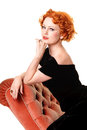 Portrait pretty redhead vintage forties dress chaise Royalty Free Stock Images