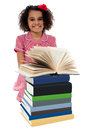 Portrait of pretty schoolgirl reading textbook image near pile books Stock Photography