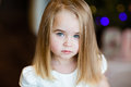 Portrait of a pretty serious girls baby blonde with straight hair, close up Royalty Free Stock Photo