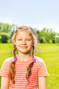 Portrait of pretty smiling girl with two braids in summer time Stock Photography