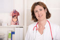 Portrait of pretty smiling physician with stethoscope. Royalty Free Stock Images