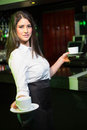 Portrait of pretty waitress serving coffee Royalty Free Stock Photo