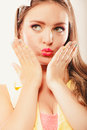 Portrait of pretty woman blowing kiss. Royalty Free Stock Photo