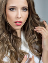 Portrait of a pretty woman with curly hair young Royalty Free Stock Photos